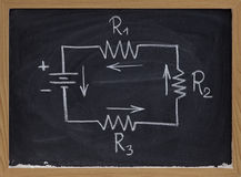 Electric circuit schematic on blackboard Royalty Free Stock Photos