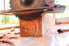 Electric circular saw cutting wood. Man using an electric circular saw cutting wood Royalty Free Stock Images