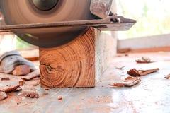 Electric circular saw cutting wood. Man using an electric circular saw cutting wood Royalty Free Stock Photo