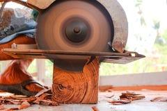 Electric circular saw cutting wood. Man using an electric circular saw cutting wood Stock Photos