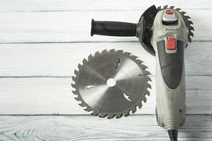 Electric circular saw on wood background. Copy space for text