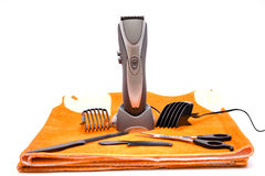 Electric clippers. With comb and scissor royalty free stock photo