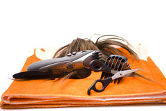 Electric clippers. Comb and scissor with towel Royalty Free Stock Photography