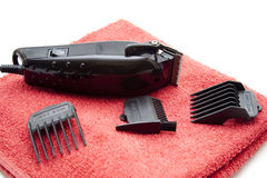Electric clippers with towel. Black electric clippers for at home Stock Image