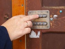Electric code lock. Pressing the code lock buttons, close up Royalty Free Stock Photography