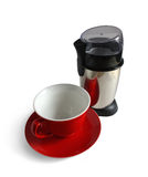 Electric coffee grinder and red cap Stock Photography