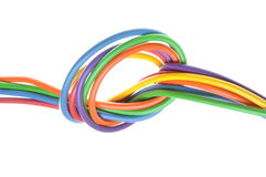 Electric colored wires with knot. Isolated on white background Stock Images