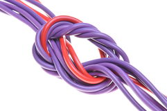 Electric colored wires with knot. Isolated on white background Royalty Free Stock Images
