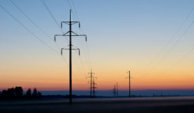 Electric columns against a decline Stock Photography