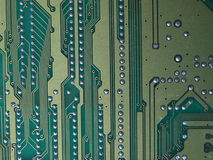 Electric Computer Chip. An close up shot of a green computer chip royalty free stock image