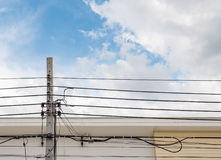 Electric concrete pole with the communication cable. Electric concrete pole with the communication cable in front of the modern house in the urban area Stock Images