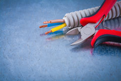 Electric conduct tubing copper cables and sharp wire cutters Stock Photography