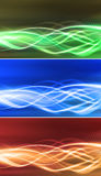 Electric connectivity flows set. Electricity glowing flows in three different colors. You can use it as a background for your company logos or you can modify it Royalty Free Stock Images