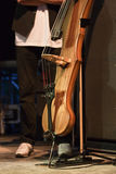 Electric contrabass with the artist on the stage. Klezmer band playing on this contrabass Royalty Free Stock Photo