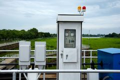 Electric control box. Of floodgate on the river Stock Photo