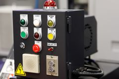 Electric control box of industrial equipment. Electric control box of automated industrial equipment. Selective focus stock photos