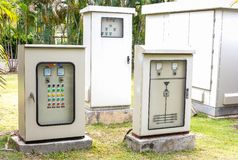 Electric control box in the park. With tree plant background stock photos