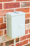 Electric control box on red brick wall Royalty Free Stock Image