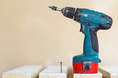 Electric cordless screwdriver and one screw close-up.  Stock Photo