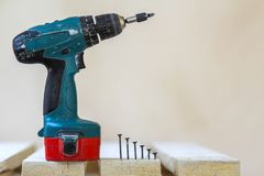 Electric cordless screwdriver and some screws close-up.  stock photos