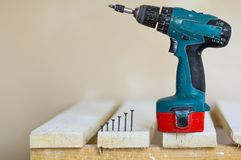 Electric cordless screwdriver and some screws Close-up. Electric cordless screwdriver and some screws close-up stock photo