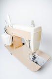Electric, cream sewing machine Stock Photos