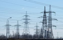Electric current transmission line. Designed for power transmission.It takes place in the under construction area of the city royalty free stock photos