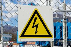 Electric danger sign. At the transformer substation Stock Photos