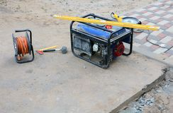 Electric diesel generator. Diesel generator for emergency electric power. Repair roads and sidewalks Royalty Free Stock Photos