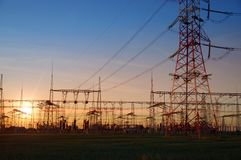 Electric distribution station. Energy transformer installation on sunset light royalty free stock photography
