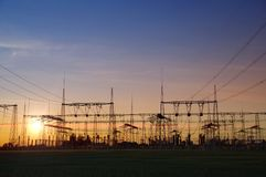 Electric distribution station. Energy transformer installation on sunset light royalty free stock photos