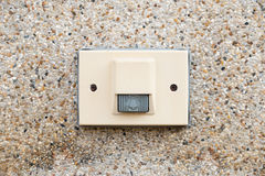 Electric door bell on rock wall. A close shot of electric door bell on rock wall Stock Images