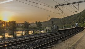 Electric double deck train with sunrise. In Uholicky village Stock Photography