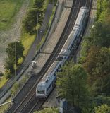 Electric double deck train in valley of river. Vltava Royalty Free Stock Photography