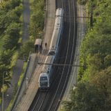 Electric double deck train in valley of river. Vltava Royalty Free Stock Photo
