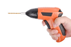 Electric drill. In hand on white background Royalty Free Stock Photo