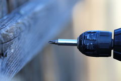 Electric Drill. A close up view of someone holding an electric drill Stock Photos