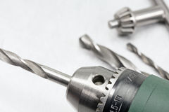 Electric drill closeup on metal surface Stock Images