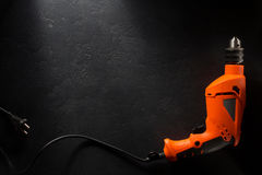 Electric drill with cord. On black background royalty free stock image