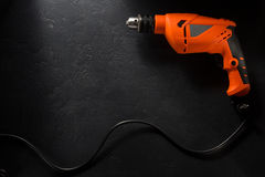 Electric drill with cord. On black background royalty free stock photos