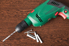 Electric drill and dowels Stock Images