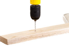 Electric drill drilling wood plank Stock Photos
