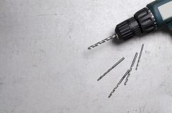 Electric drill on grey background. Space for text stock image