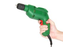 Electric drill in a hand isolated on white. Stock Photography