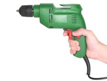 Electric drill in a hand isolated on white. Royalty Free Stock Images
