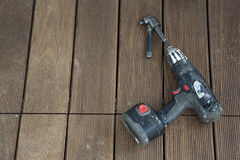 Electric drill left on wooden floor Stock Photography