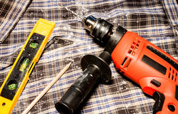 Electric drill and level measuring Royalty Free Stock Image