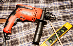Electric drill and level measuring Royalty Free Stock Photo