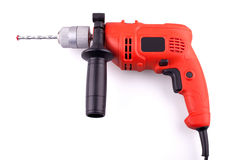 Electric drill. Orange electric drill with handle on white background Stock Image