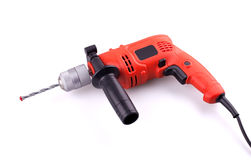Electric drill. Orange electric drill with handle on white background Royalty Free Stock Photo